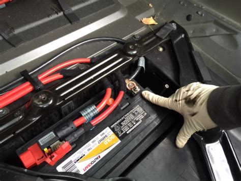 Where Is The Battery Located In A 2005 Bmw X5