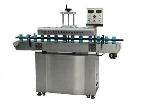 automatic electromagnetic induction aluminum foil sealing machine   price  xinhui