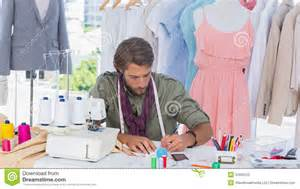 clothes designer fashion designer drawing on a desk stock photo image 31800120