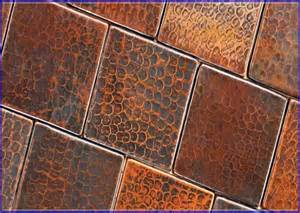 warm and friendly copper tile backsplash