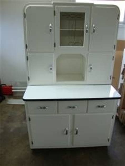 White kitchen Hoosier pull out enamel top table. Has