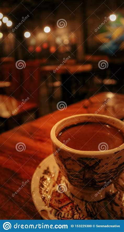 Sounds include smooth jazz, rain sounds, soft chatter. A Cup Of Coffee Served On A Wooden Table With A Calm Ambience Coffee Shop Stock Photo - Image of ...