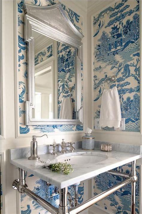 white  blue powder room features walls clad  trim