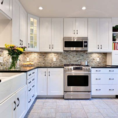 White Kitchen Cupboards With Black Countertops by White Cabinets With The Multi Backsplash Counters