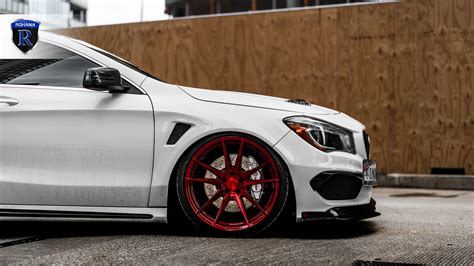 They also have customizable ambient interior lighting that includes illuminated circular air vents in the instrument. Mercedes-Benz CLA45 AMG | Gloss Red RFX2 - Rohana Wheels