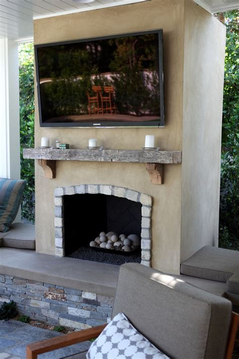 outdoor stucco fireplace smooth stucco fireplace with lompoc cobblestone and a reclaimed wood mantle dig fireplaces