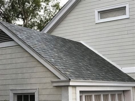 tesla s solar roof to cost less than a normal roof geeky