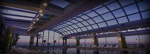 Custom retractable roof systems libart usa libart usa for Indoor pool with retractable roof