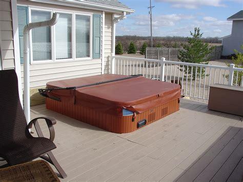 tub decking desk design idea features half under ground hot tub with cover decofurnish