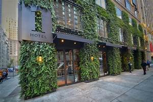 The, Nyc, Green, Wall, Framing, The, Doors, And, Windows, Of, 1, Hotel