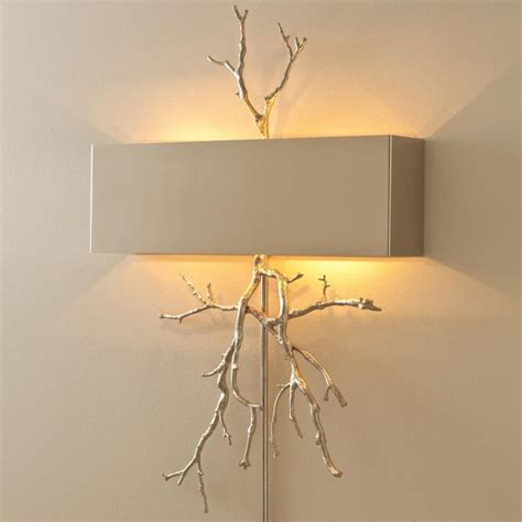 sculptural twig wall sconce available in 2 colors brass
