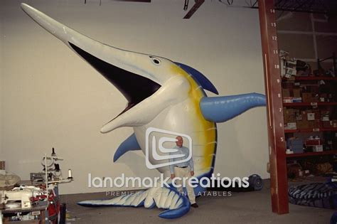 giant inflatable smiling marlin character