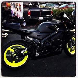 Black Honda CBR with bright yellow wheels
