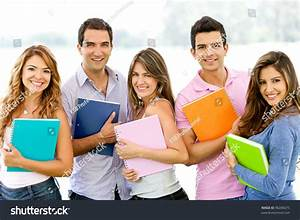 Happy Group Students Holding Notebooks Outdoors Stock ...