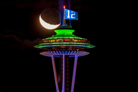 space needle tower   man flag  colorful lights
