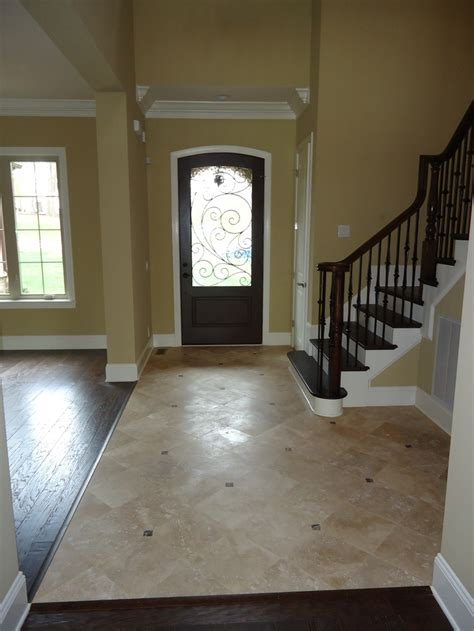 the saddlebrook foyer with travertine flooring and wrought