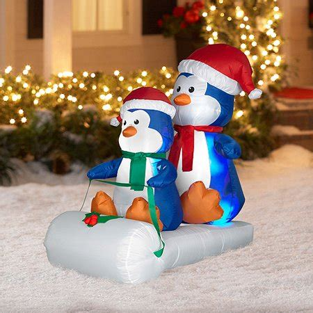 tall   long airblown penguins  sled christmas