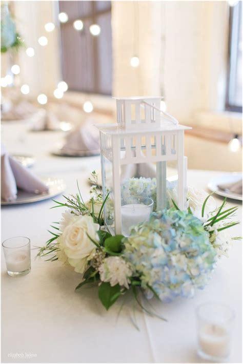 White Lantern Centerpieces With Blue Hydrangea With White