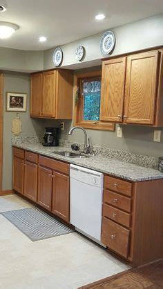 granite  tie  oak cabinets  white appliances blanco tulum granite gettysburg