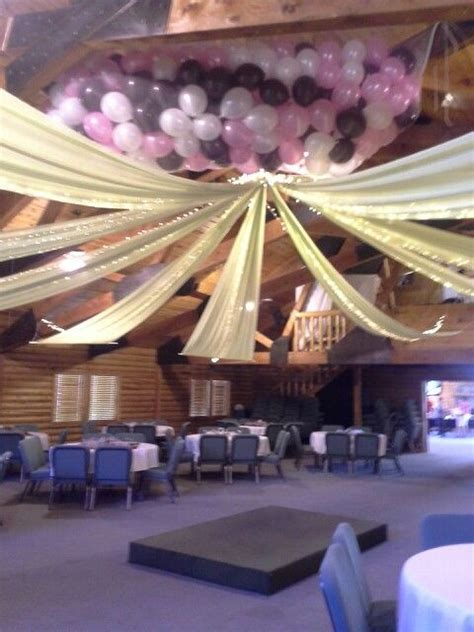 diy ceiling drape and baloon drop you can pull it off