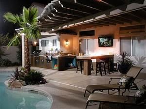 Dim lighting illuminate outdoor kitchen with natural wood
