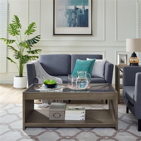 O&k furniture square coffee table with 4 nesting the glass table top highlights the contemporary design of the table and is perfect for displaying tea this rectangular shaped coffee table is made of a wooden frame and tufted leather ottoman on top. Modern Essentials Georgette Rustic Farm House Solid Wood Coffee Table with Glass Top, Multiple ...
