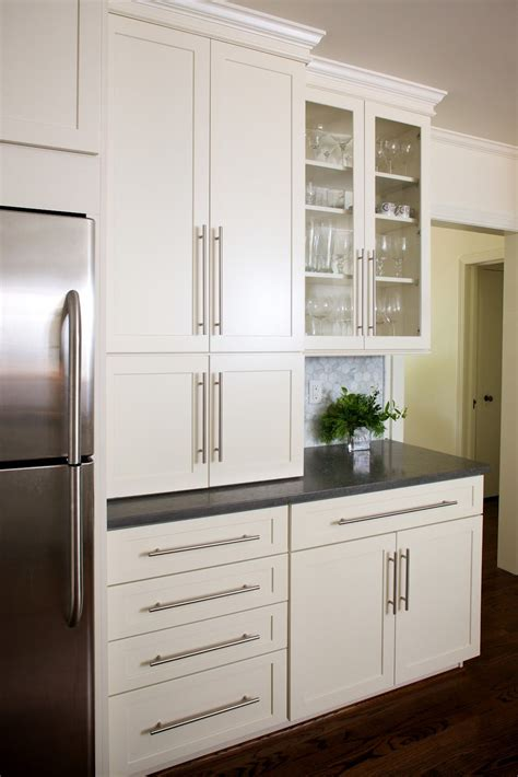 Traditional black cabinets can work with a broad range of decorating styles. classic and modern white kitchen (just this picture. Not a link to the post) | Modern kitchen ...
