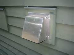 Exterior Wall Exhaust Vent Cover by ERV Installed Up Hill House