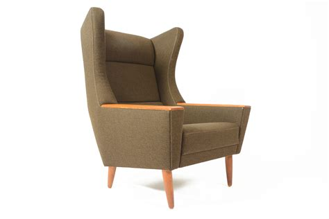modern wingback lounge chair in olive mid century