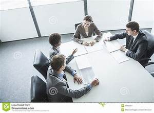 Four Business People Sitting Around A Table And Having A ...