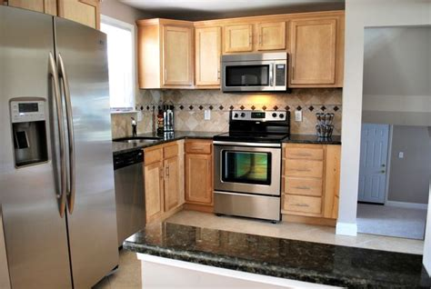 light maple cabinets with granite kitchen design