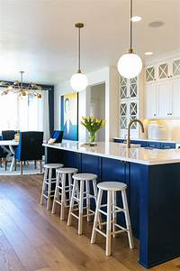 Photos hgtv blue and white kitchen with island stools for Best brand of paint for kitchen cabinets with lamps plus wall art