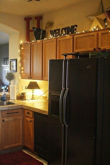 Ideas For On Top Of Kitchen Cabinets by 25 Awesome Ways To Use String Lights In Kitchens Digsdigs