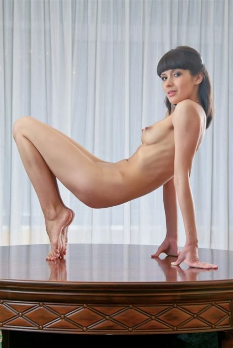Brunette With Bangs Posing Naked On The Table Russian Sexy Girls