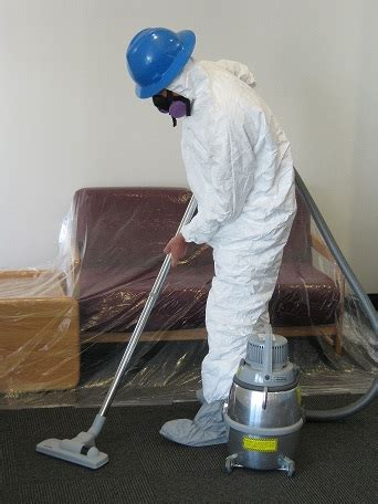 worker  hazmat suit   hepa vacuum