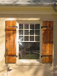 wood exterior shutters Stylish wood shutters for privacy and elegance – CareHomeDecor