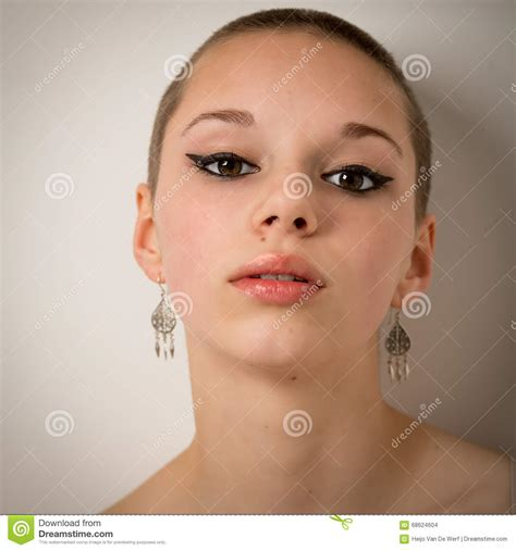 Beautiful Young Teenage Girl With A Shaven Head Stock