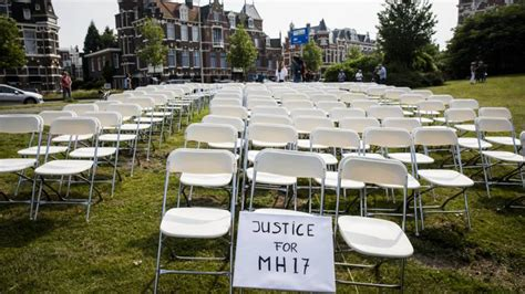 Malaysia airlines flight 17 (mh17) was a scheduled passenger flight from amsterdam to kuala lumpur that was shot down on 17 july 2014 while flying over eastern ukraine. 298 empty chairs for all victims of MH17 in front of Russian Embassy : pics