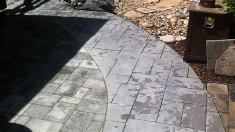 installing pavers next to concrete paver patio