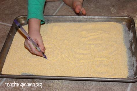 10 pre writing activities for preschoolers 608 | Prewriting Activity in Corn Meal