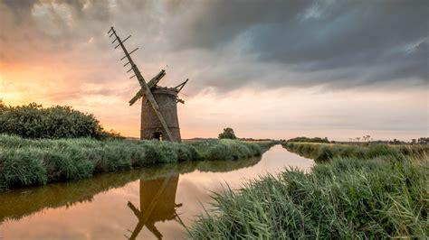 full hd wallpaper river grass windmill ruin overcast