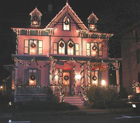 pink victorian house decorated  christmas pictures
