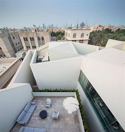 agi architects hides wall house  kuwait  stone facade