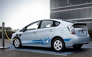 Plug-in Hybrid - Car In Parking Lot Charging