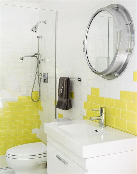 white and yellow bathroom with yellow subway tiles