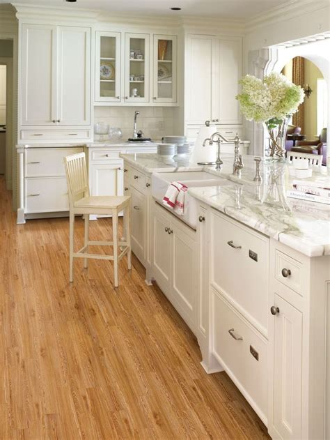 white kitchen cabinets wood floors for a cozy yet modern kitchen pair your light wood floors 1814