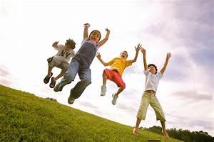 children jumping in air at park_Robert_Holland.jpg ...