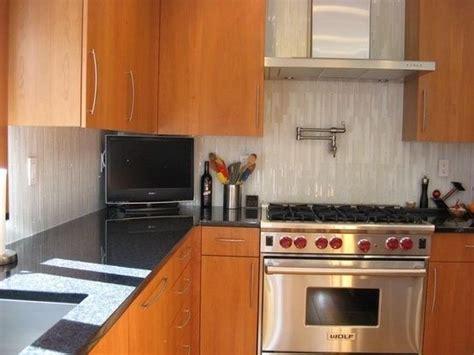 vertical linear tile backsplash by kitchen