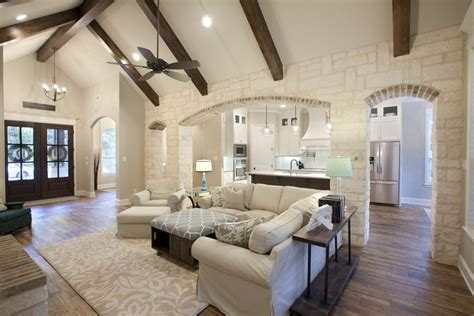 brick  stone archway open concept living room  wood tile flooring mckinney homes