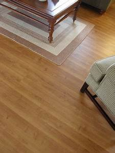Floating laminate flooring in snap and lock panels in a for Wood floor snap lock